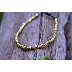 Glücksarmband aus Oktagon Perlen Gold